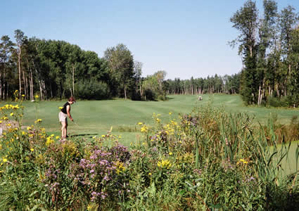 Golfer enjoys Memorial Lake Golf Course