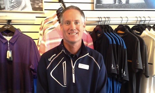 John Swanson standing in the golf shop.