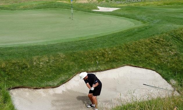 Golfer Bob Spearman in a deep gully on Hole 5 at Tower Ranch.