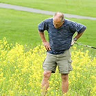 Photo of a man looking for a golf ball