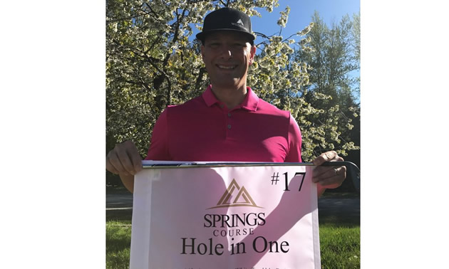 Golf pro Doug Schneider with proof of his hole-in-one shot at the Springs Golf Course in Radium Hot Springs.